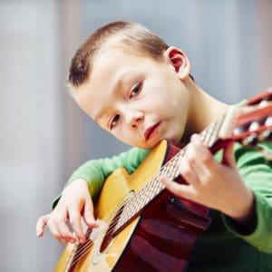 A Guide To Boost Your Child's Academic Performance with Music Lessons!