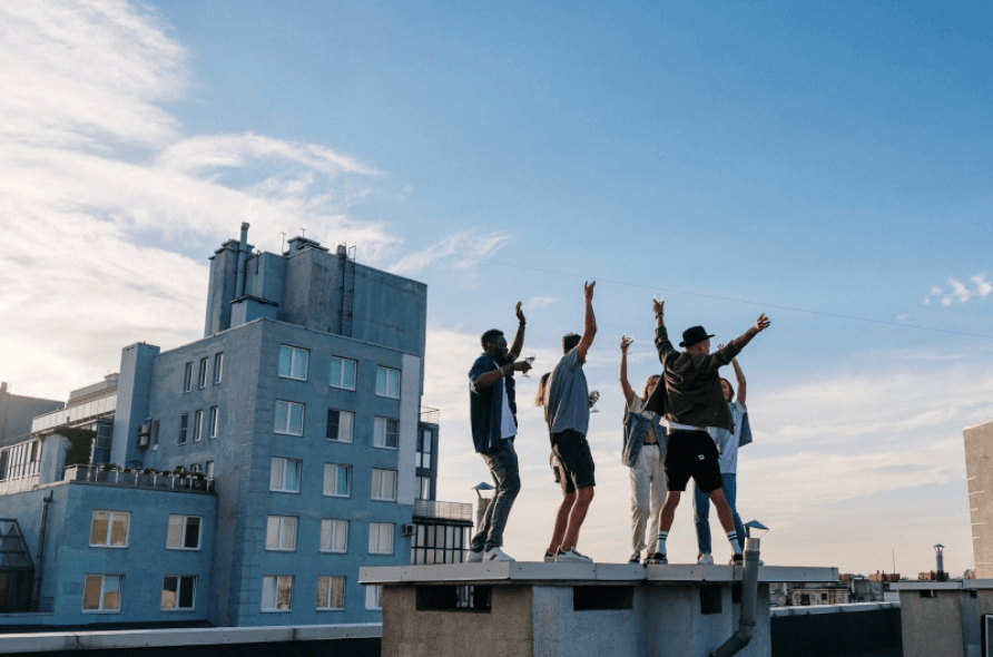 men jumping on top of building