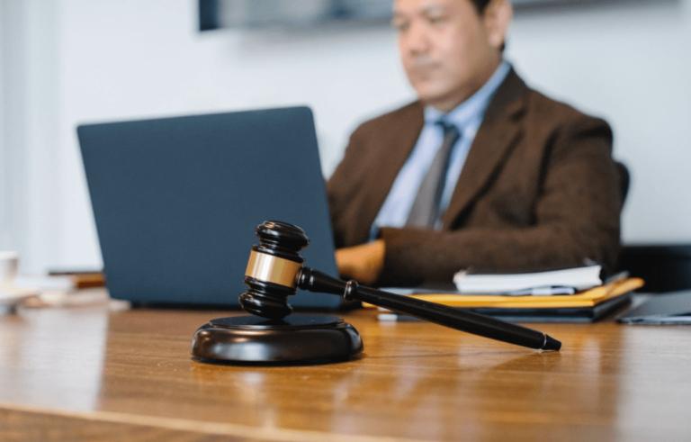 judge working on laptop